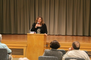 MATT SCHICKLING / WIRE PHOTO Abington author Wendy Tyson spoke to a group assembled at the auditorium at Rydal Park in Jenkintown on May 20.
