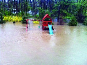 PHOTO COURTESY OF ED NINI Homeowner Ed Nini's backyard in Lower Makefield has flooded twice since last October. Local residents will now be required to purchase flood insurance and may not be grandfathered in for lower premiums.