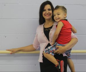 JACK FIRNENO / WIRE PHOTO Gabby Favoroso smiles with her son at Standing Ovations, a new performing arts center she launched this month in a storefront on Route 13 near Bath Street. The studio features a variety of classes including ballet, tap dancing, singing and acting.