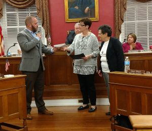 JACK FIRNENO / TIMES PHOTO Left to right: Borough council member Greg Pezza presents a donation and proclamation to Jan Ruano and Mary McIlvain of the Bristol Cultural and Historical Foundation.