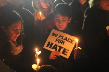 MATT SCHICKLING / TIMES PHOTO Community members gather for a candlelight vigil after race-related incidents were reported at Council Rock High North in November 2016.